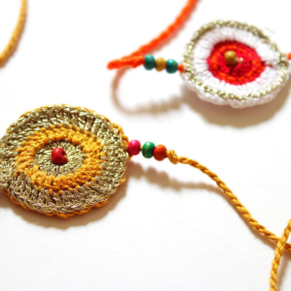 Sattviko Rakhi Combo - Gur Chana with Artisan Crochet Rakhi + 1 Normal Rakhi Band + Roli | Rakhi Gift Hamper with Roli Moli